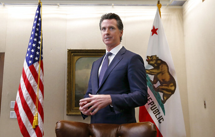 Gov. Gavin Newsom discusses his decision to fire state Oil and Gas Supervisor Ken Harris while talking with reporter's at his office in Sacramento, Calif., Friday, July 12, 2019. Newsom said he fired Harris, Thursday, July 11, 2019, because he did not