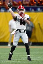 Georgia quarterback JT Daniels throws a passagainst Clemson during the first half of an NCAA college football game Saturday, Sept. 4, 2021, in Charlotte, N.C. (AP Photo/Chris Carlson)