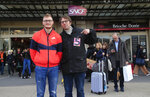 In this photo taken Saturday Nov. 30, 2019, Gilles Pierre, right, a metro driver for the Paris public transport company RATP, and Vincent Le Faucheur, 23, a train traffic controller for the national railway company SNCF pose at the Gare de Lyon train station in Paris. France is getting ready for massive, nationwide transport strikes Thursday, disrupting trains, buses and airlines, protesting against government plans to overhaul the state pension system. (AP Photo/Michel Euler)