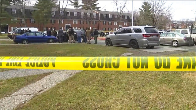 This image provided by WMAR-2 News shows emergency and law enforcement officials responding to the scene of a shooting,  Wednesday, Feb. 12, 2020 in Baltimore.  Two law enforcement officers with a fugitive task force were injured and a suspect died in a shooting on Wednesday, the U.S. Marshals Service said. (WMAR-2 News via AP)