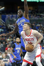Houston Rockets center Isaiah Hartenstein, right, looks to shoot as he gets in front of Orlando Magic center Mo Bamba during the first half of an NBA basketball game, Friday, Dec. 13, 2019, in Orlando, Fla. (AP Photo/John Raoux)
