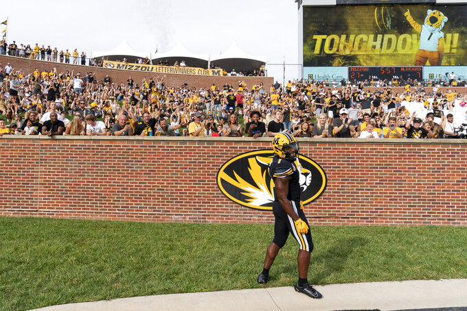 Missouri running back Tyler Badie celebrates his touchdown in front of the end zone crowd during the second quarter of an NCAA college football game against North Texas, Saturday, Oct. 9, 2021, in Columbia, Mo. (AP Photo/L.G. Patterson)