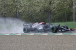 Mercedes driver Lewis Hamilton of Britain steers his car during the Emilia Romagna Formula One Grand Prix, at the Imola racetrack, Italy, Sunday, April 18, 2021. (AP Photo/Luca Bruno)