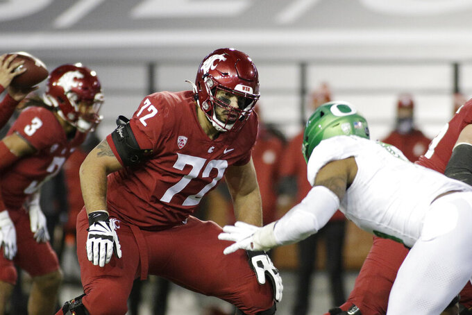 FILE - Washington State offensive lineman Abraham Lucas, left, prepares to block Oregon defensive end Kayvon Thibodeaux during the first half of an NCAA college football game in Pullman, Wash., in this Saturday, Nov. 14, 2020, file photo. Already one of the best pass protectors in the country, Lucas will add to his game with another year in an offense featuring more runs and tighter line splits. (AP Photo/Young Kwak, File)