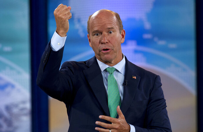 FILE - In this Sept. 19, 2019, file photo, Democratic presidential candidate former Maryland Rep. John Delaney speaks during the Climate Forum at Georgetown University in Washington. Democratic presidential candidates are trying to lure donors to their campaigns through free trips, raffles and tickets as they work to stay afloat in the crowded field. Delaney is giving away a trip for two to join in him in Washington for Game 4 of the World Series (AP Photo/Jose Luis Magana, File)