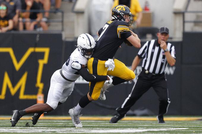 Penn State linebacker Curtis Jacobs (23) sacks Iowa quarterback Spencer Petras (7) during the first half of an NCAA college football game, Saturday, Oct. 9, 2021, in Iowa City, Iowa. (AP Photo/Matthew Putney)