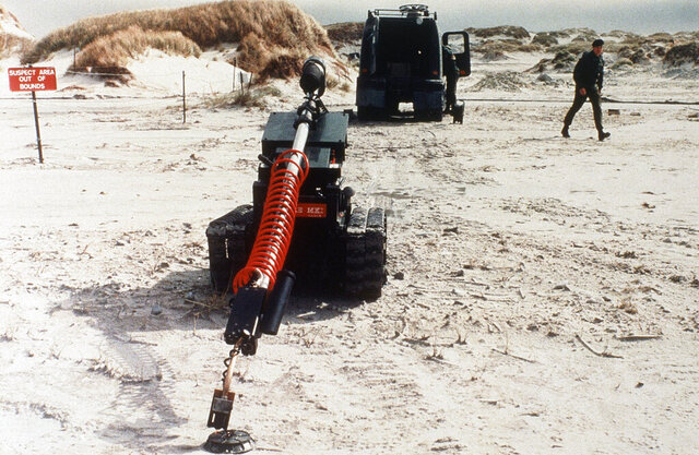 "FILE - In this Dec. 10, 1985 file photo, ""Redfire,"" a remote-controlled robot, undergoes testing in a mine clearance operation by British army troops in the Falkland Islands. Britain's Foreign Office has on Tuesday, Nov. 10, 2020 the Falklands will soon be landmine free - almost 40 years after the end of the conflict. The U.K. funded program, which started in 2009, is set to end three years ahead of schedule. With the completion of the program, no anti-personnel mines will remain on British soil. (AP Photo/John Leonard, file)"