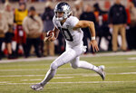 Oregon quarterback Justin Herbert (10) carries the ball against Utah in the second half during an NCAA college football game Saturday Nov. 10, 2018, in Salt Lake City. (AP Photo/Rick Bowmer)