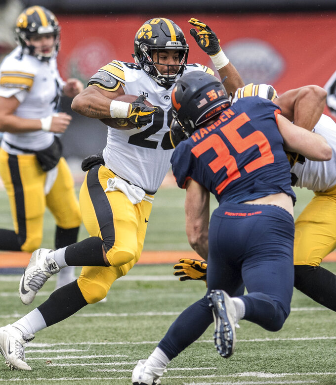 Iowa's Toren Young (28) runs the ball in the first half of a NCAA college football game against Illinois, Saturday, Nov. 17, 2018, in Champaign, Ill. (AP Photo/Holly Hart)