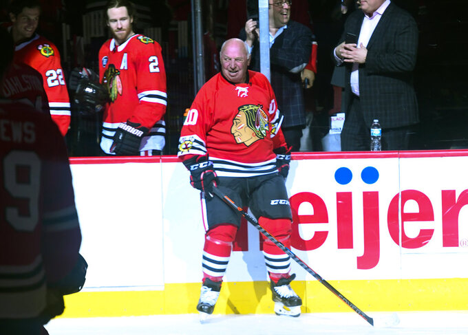 "Former Chicago Blackhawks player Dennis Hull was honored in a ""One More Shift"" ceremony before an NHL hockey game between the Blackhawks and the Calgary Flames on Monday Jan. 7, 2019, in Chicago. (AP Photo/Matt Marton)"