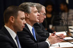 FBI Director Christopher Wray, flanked by Acting Homeland Security Secretary Kevin McAleenan, left, and acting Director of the National Counterterrorism Center at the office of the Director of National Intelligence Russell Travers, right, testifies before the House Homeland Security Committee on Capitol Hill in Washington, Wednesday, Oct. 30, 2019, during a hearing on domestic terrorism. (AP Photo/Susan Walsh)