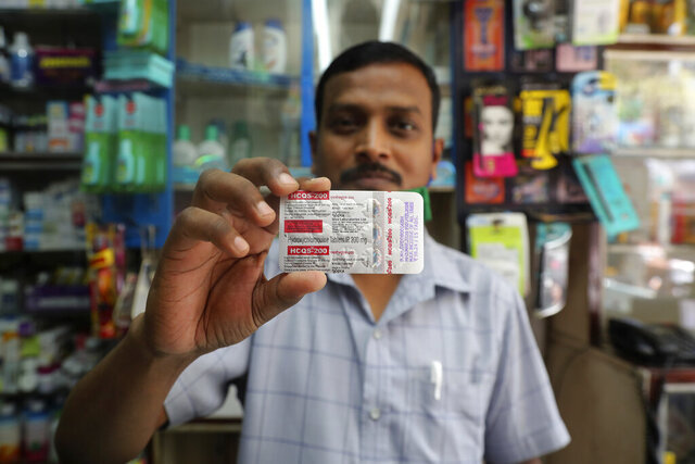 A chemist displays hydroxychloroquine tablets in Mumbai, India, Tuesday, May 19, 2020. President Donald Trump's declaration that he was taking the antimalarial drug of dubious effectiveness to help fend off the coronavirus will be welcomed in India. Trump's previous endorsement of hydroxychloroquine catalyzed a tremendous shift in the South Asian country, spurring the world's largest producer of the drug to make much more of it, prescribe it for front-line health workers treating cases of the coronavirus and deploy it as a diplomatic tool, despite mounting evidence against using the drug for COVID-19. (AP Photo/Rafiq Maqbool)