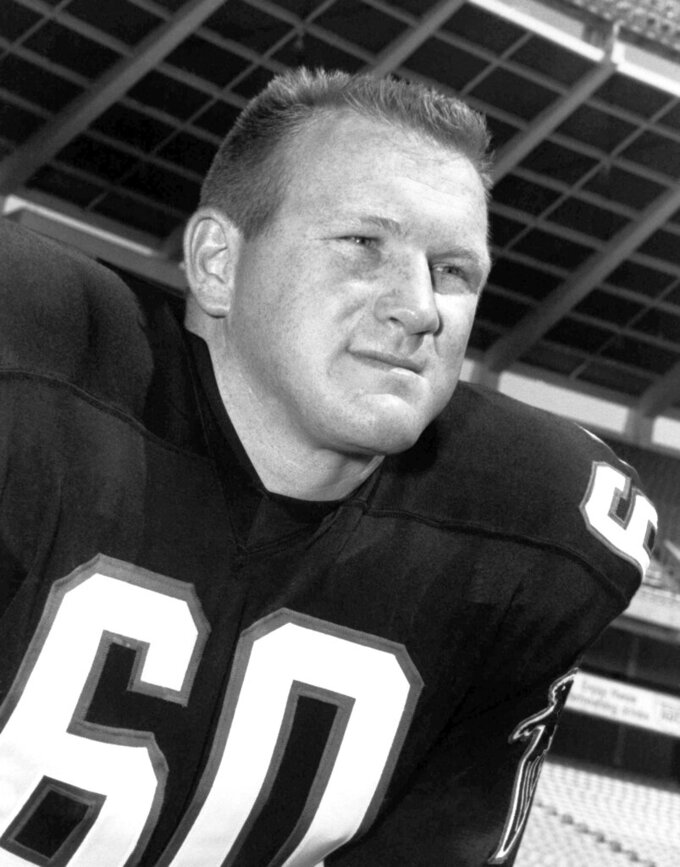 "FILE - In this Dec. 13, 1966, file photo, Tommy Nobis of the Atlanta Falcons, poses. Nobis, a hard-hitting linebacker for Atlanta and the University of Texas who earned the nickname ""Mr. Falcon,"" had the most severe form of chronic traumatic encephalopathy. And now, as Atlanta prepares to host the Super Bowl, the descent of the NFL upon their hometown is a reminder for his family of the impact, both good and bad, that football has had on them. (AP Photo/File)"