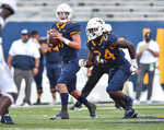 West Virginia quarterback Garrett Greene (11) looks to pass against Eastern Kentucky during an NCAA college football game Saturday, Sept. 12, 2020, in Morgantown, W.Va. (William Wotring/The Dominion-Post via AP)