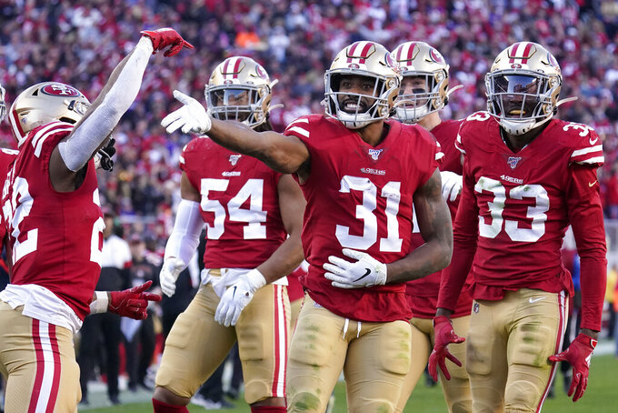 San Francisco 49ers' Raheem Mostert (31) celebrates with teammates after recovering a fumble against the Minnesota Vikings during the second half of an NFL divisional playoff football game, Saturday, Jan. 11, 2020, in Santa Clara, Calif. (AP Photo/Tony Avelar)