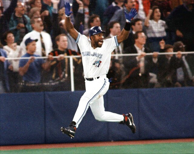 FILE - In this Oct. 23, 1993, file photo, Toronto Blue Jays' Joe Carter celebrates his game winning three-run home run in the ninth inning of Game 6 of the World Series against the Philadelphia Phillies in Toronto. The Toronto Blue Jays won back to back World Series in 1992-1993. (AP Photo/Mark Duncan, File)
