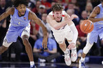 North Carolina guard Leaky Black, left, and Gonzaga forward Corey Kispert go after the ball during the first half of an NCAA college basketball game in Spokane, Wash., Wednesday, Dec. 18, 2019. (AP Photo/Young Kwak)