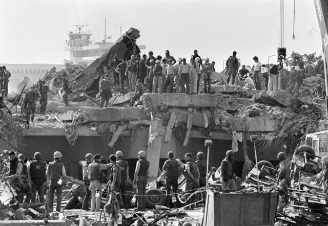 FILE - In this Oct. 24,1983 file photo, rescuers continue to probe the wreckage of the U.S. Marine barracks a day after a suicide truck bomb near Beirut airport, Lebanon. It was a century ago on Sept. 1, 1920, that a French general, Henri Gouraud, stood on the porch of the French residence in Beirut surrounded by local politicians and religious leaders and declared the State of Greater Lebanon - the precursor to the modern state of Lebanon. (AP Photo/Zouki, File)
