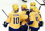 Nashville Predators center Kyle Turris, center, is congratulated after scoring a goal against the Los Angeles Kings during the second period of an NHL hockey game Saturday, Nov. 17, 2018, in Nashville, Tenn. (AP Photo/Mark Zaleski)