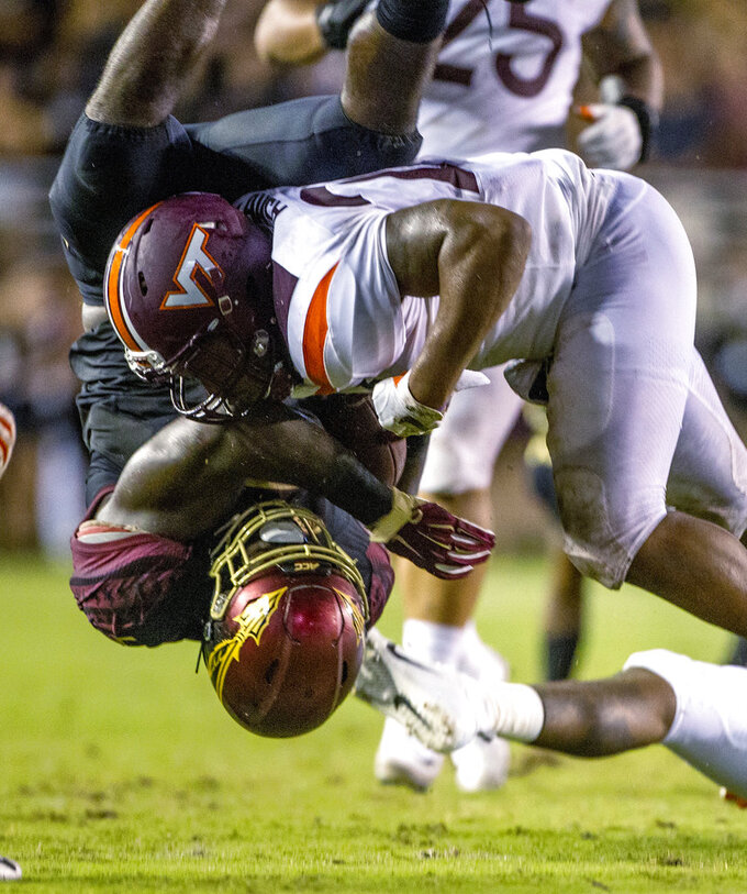 FILE - In this Sept. 3, 2018, file photo, Virginia Tech Virginia Tech linebacker Rayshard Ashby (23) upends Florida State running back Jacques Patrick (9) during an NCAA college football game in Tallahassee, Fla. Florida State (1-2) has allowed 10 sacks and generated only 156 rushing yards in its FBS losses, managing just a field goal and a touchdown in lopsided losses to Virginia Tech and at Syracuse. (AP Photo/Mark Wallheiser, File)