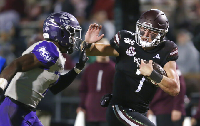 Mississippi State quarterback Tommy Stevens (7) fights off a tackle attempt by an Abilene Christian player, on his way to a second-half 30-yard touchdown run during an NCAA college football game Saturday, Nov. 23, 2019 in Starkville, Miss. Mississippi State won 45-7. (Keith Warren/The Clarion-Ledger via AP)