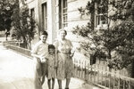 This undated photo provided by the Bernie Sanders campaign in July 2019 shows him as a child, center, and his brother, Larry, with their maternal grandmother, Bessy Glassberg, outside 1525 E. 26th St., the building where he grew up, in the Brooklyn borough of New York. The future presidential candidate, now 77, was raised in the close-knit Midwood neighborhood in the years just before and after the Korean War. The area still looks much the same as it did then, with mid-rise art deco apartment buildings, including the one Sanders grew up in, edging Kings Highway and the neatly kept houses on side streets. (Bernie Sanders campaign via AP)