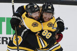 Boston Bruins right wing David Pastrnak (88) celebrates his goal against the Winnipeg Jets with teammate David Krejci during the third period of an NHL hockey game Thursday, Jan. 9, 2020, in Boston. It was his third goal of the game. (AP Photo/Elise Amendola)