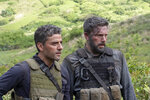 This image released by Netflix, shows Oscar Isaac, left and Ben Affleck in a scene from the film,