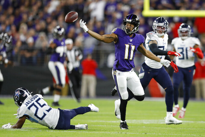 Baltimore Ravens wide receiver Seth Roberts (11) can't catch a pass as he is covered by Tennessee Titans strong safety Kenny Vaccaro (24) during the first half an NFL divisional playoff football game, Saturday, Jan. 11, 2020, in Baltimore. (AP Photo/Julio Cortez)