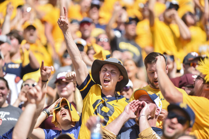 West Virginia fans reacts during the second half of an NCAA college football game against Virginia Tech in Morgantown, W.Va., Saturday, Sep. 18, 2021. (AP Photo/William Wotring)