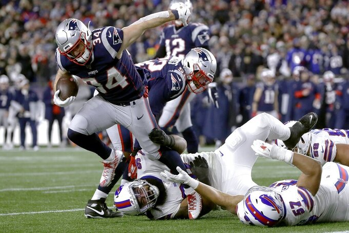 New England Patriots running back Rex Burkhead breaks loose from an attempted tackle to run for a touchdown against the Buffalo Bills in the second half of an NFL football game, Saturday, Dec. 21, 2019, in Foxborough, Mass. (AP Photo/Steven Senne)