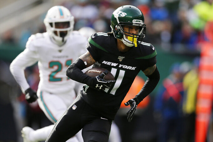 New York Jets wide receiver Robby Anderson (11) runs for a touchdown during the second quarter of an NFL football game against the Miami Dolphins, Sunday, Dec. 8, 2019, in East Rutherford, N.J. (AP Photo/Adam Hunger)
