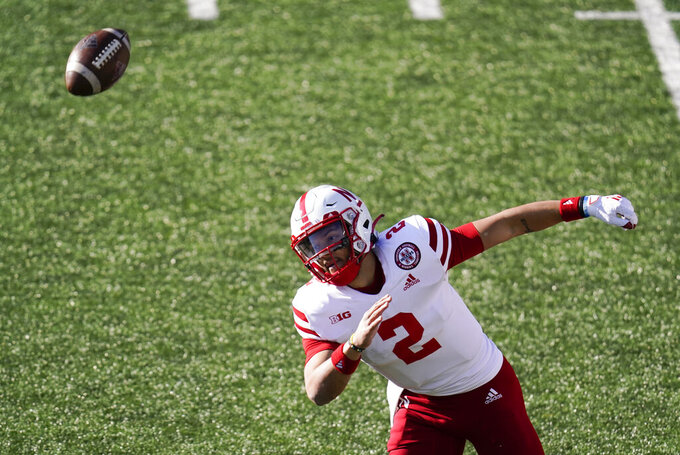 Nebraska quarterback Adrian Martinez chases down a fumbled snap during the first half of an NCAA college football game against Iowa, Friday, Nov. 27, 2020, in Iowa City, Iowa. (AP Photo/Charlie Neibergall)