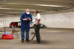 State Sen. Benny Shendo, right, speaks with a healthcare worker before receiving a routine COVID-19 test in the parking garage the state capital building Monday, June 15, 2020, in Santa Fe, New Mexico. Shendo, of Jemez Pueblo, got the test along with other legislators and state workers ahead of a special session that starts June 18.  (AP Photo/Cedar Attanasio)