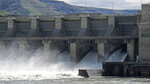FILE - In this April 11, 2018, file photo, water moves through a spillway of the Lower Granite Dam on the Snake River near Almota, Wash. A coalition of 17 environmental groups are speaking out against a key part of a sweeping plan to remove the lower Snake River dams to save salmon and steelhead. The groups said in a letter to Democratic senators in Oregon and Washington that the 35-year moratorium on fish- and dam-related lawsuits included in Idaho Republican Rep. Mike Simpson's proposal in exchange for dam removal was too high a price to pay, the Idaho Statesman reported Saturday, March 27, 2021. (AP Photo/Nicholas K. Geranios, File)