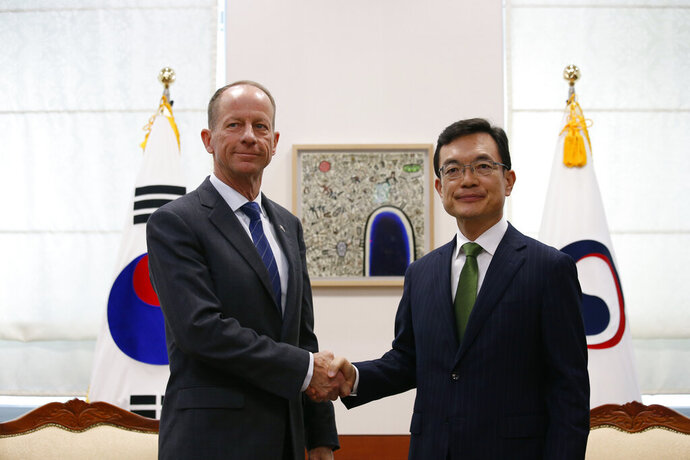David Stilwell, left, U.S. assistant secretary for East Asian and Pacific Affairs, and his South Korean counterpart Cho Sei-young pose for photos during their meeting at the Foreign Ministry in Seoul, South Korea, Wednesday, Nov. 6, 2019. (Heo Ran/Pool Photo via AP)