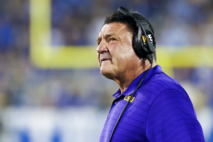 LSU coach Ed Orgeron looks up at the video board during the first half of the tealm's NCAA college football game against Kentucky in Lexington, Ky., Saturday, Oct. 9, 2021. (AP Photo/Michael Clubb)