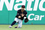 Cleveland Indians right fielder Tyler Naquin makes a sliding catch on a flyout by Texas Rangers' Delino DeShields in the third inning of a baseball game in Arlington, Texas, Monday, June 17, 2019. (AP Photo/Tony Gutierrez)
