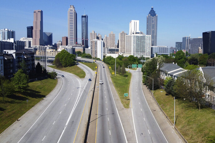 Lighter than normal traffic flow in and out downtown Atlanta Monday, April 6, 2020. Gov. Brian Kemp has issued an order to shelter in place in hopes of slowing the spread of the coronavirus. (AP Photo/John Bazemore)