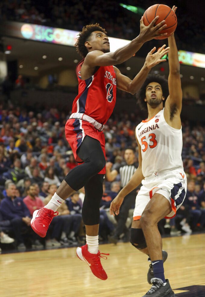 Stony Brook guard Tavin Pierre Philippe (15) shoots next to Virginia guard Tomas Woldetensae (53) during an NCAA college basketball game in Charlottesville, Va., Wednesday, Dec. 18, 2019. (AP Photo/Andrew Shurtleff)