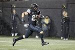 Vanderbilt running back Mitchell Pryor runs 31 yards for a touchdown against ETSU in the second half of an NCAA college football game Saturday, Nov. 23, 2019, in Nashville, Tenn. Vanderbilt won 38-0. (AP Photo/Mark Humphrey)