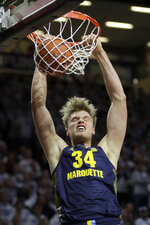 Marquette center Jayce Johnson dunks during the first half of the team's NCAA college basketball game against Kansas State in Manhattan, Kan., Saturday, Dec. 7, 2019. (AP Photo/Orlin Wagner)
