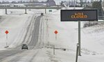 The eastbound lanes of Interstate 94 were closed at Exit 161 on Wednesday evening and remained closed Thursday, March 14, 2019 until snowplows could clear the east-west interstate highway of drifted snow near Bismarck.   North Dakota transportation officials closed sections of major interstates after blowing snow reduced visibility to nearly zero (Tom Stromme/The Bismarck Tribune via AP)