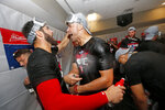 St. Louis Cardinals starting pitcher Jack Flaherty, right, celebrates with teammate Daniel Ponce de Leon after the Cardinals beat the Atlanta Braves 13-1 in Game 5 of their National League Division Series baseball game Wednesday, Oct. 9, 2019, in Atlanta. (AP Photo/John Bazemore)