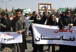 """Afghans shout slogans during an anti-Pakistan demonstration, near the Pakistan embassy in Kabul, Afghanistan, Tuesday, Sept. 7, 2021. Signs in Persian read, """"Pakistan Pakistan Get out of Afghanistan."""" (AP Photo/Wali Sabawoon)"""