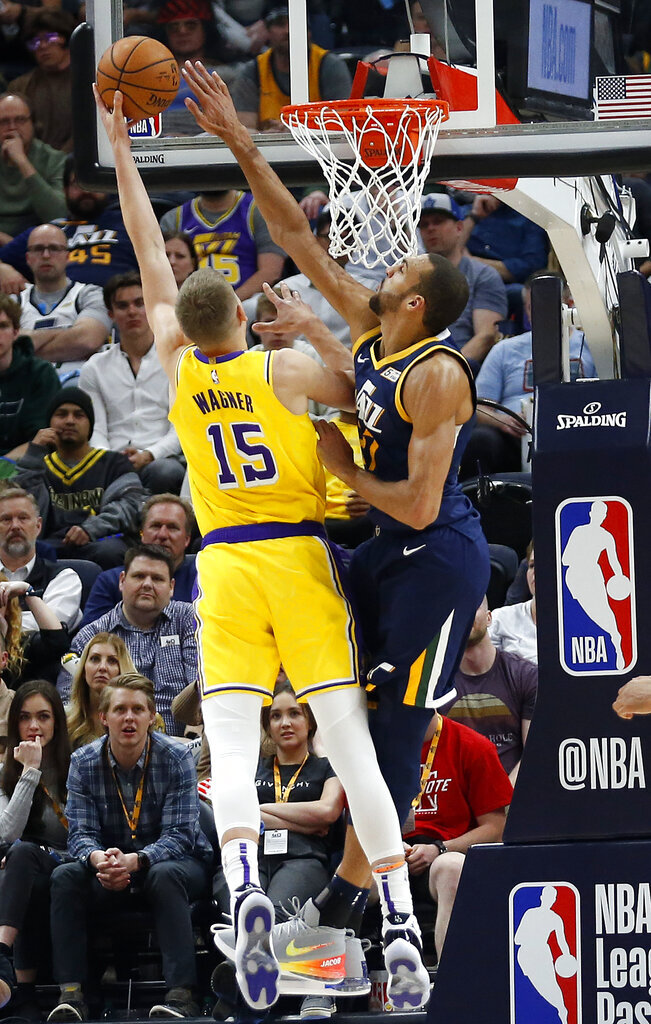 Utah Jazz center Rudy Gobert, right, defends against Los Angeles Lakers center Moritz Wagner (15) during the second half of an NBA basketball game Wednesday, March 27, 2019, in Salt Lake City. (AP Photo/Rick Bowmer)