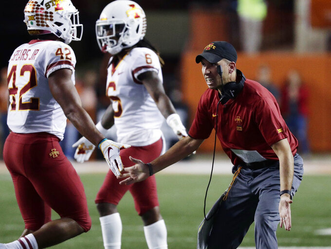 Iowa State head coach Matt Campbell, right, receives his players to the sideline during the first half of an NCAA college football game against Texas , Saturday, Nov. 17, 2018, in Austin, Texas. (AP Photo/Eric Gay)