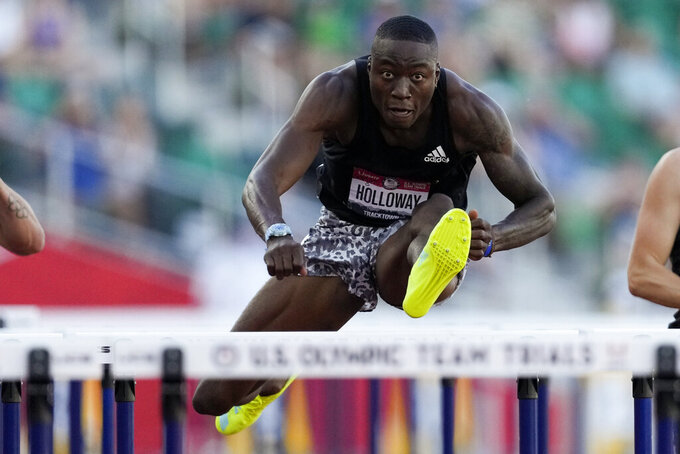 Grant Holloway, right, wins the final in the men's 110-meter hurdles at the U.S. Olympic Track and Field Trials Saturday, June 26, 2021, in Eugene, Ore. (AP Photo/Ashley Landis)
