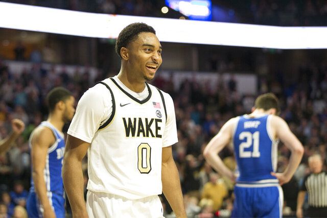 Wake Forest guard Brandon Childress (0) is all smiles in double overtime of an NCAA college basketball game against Duke, Tuesday, Feb. 25, 2020, in Winston-Salem, N.C.  Brandon Childress hit a tying 3-pointer late in regulation and finished with 17 points to help Wake Forest stun seventh-ranked Duke 113-101 in double overtime. (AP Photo/Lynn Hey)