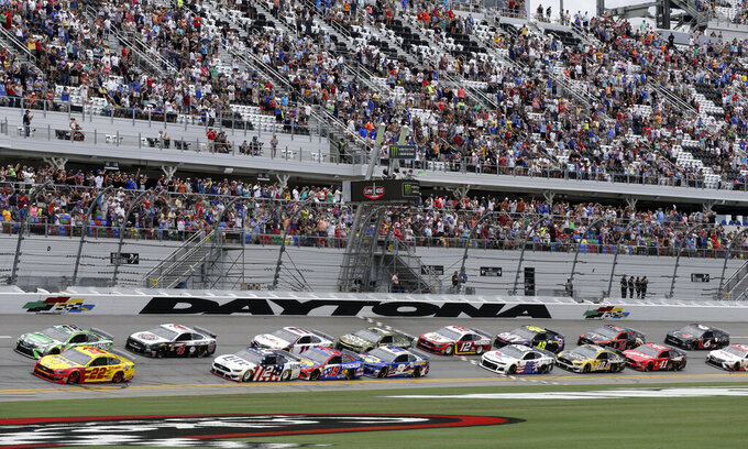 Joey Logano (22) and Kyle Busch (18) lead the field to start the NASCAR Cup Series auto race at Daytona International Speedway, Sunday, July 7, 2019, in Daytona Beach, Fla. (AP Photo/Terry Renna)